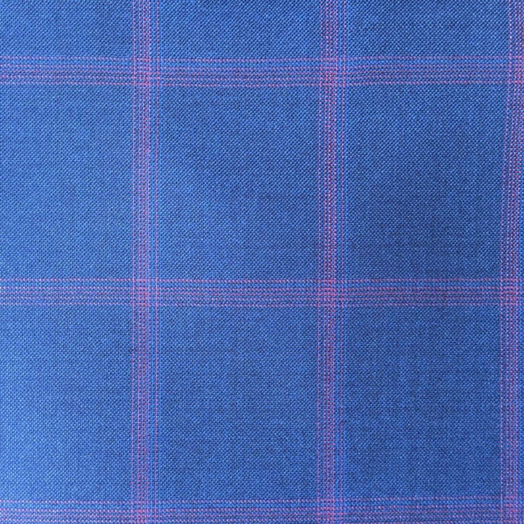 Hochwertigste Schurwollen S150 Qualität mit 15% Seidenbeimischung auf Indigo blauer Basis und trendigem roten Gitterkaro